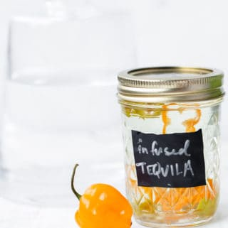 Habanero Infused Tequila adds the perfect little spicy punch to all your tequila cocktails! infused tequila | tequila | how to infuse tequila | how to infuse tequila with habanero | tequila infused with habanero jalapeno | mango habanero margarit