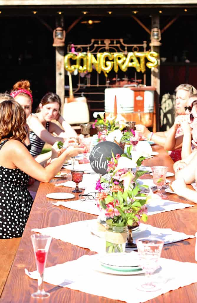 gather around the table at a greatest adventure party