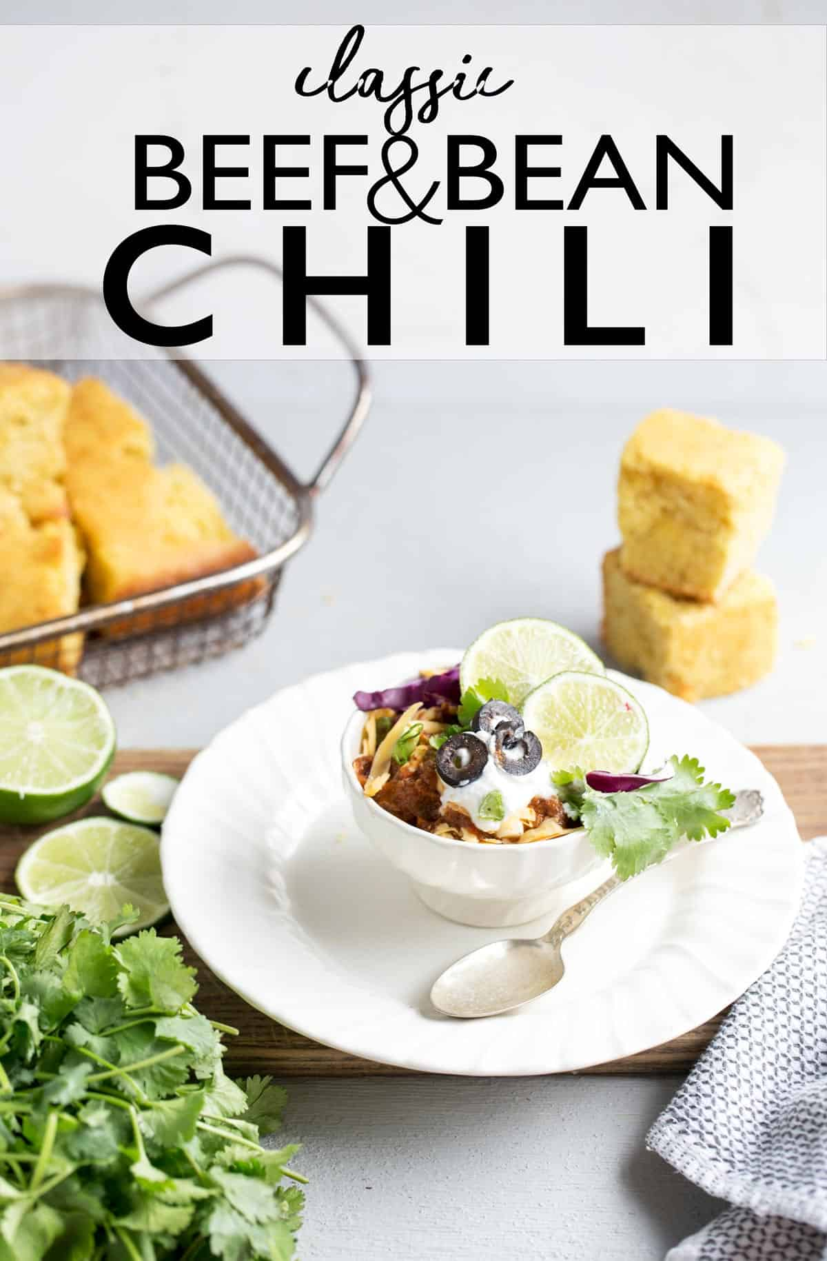 Classic American Beef and Bean Chili with Cornbread and Honey Butter gets it's deep rich smoky chili flavor from a slow stovetop simmer. Served buffet style with an assortment of toppings, it's a perfect meal to please the whole family friendly dinner or as a self service dinner at your next party!