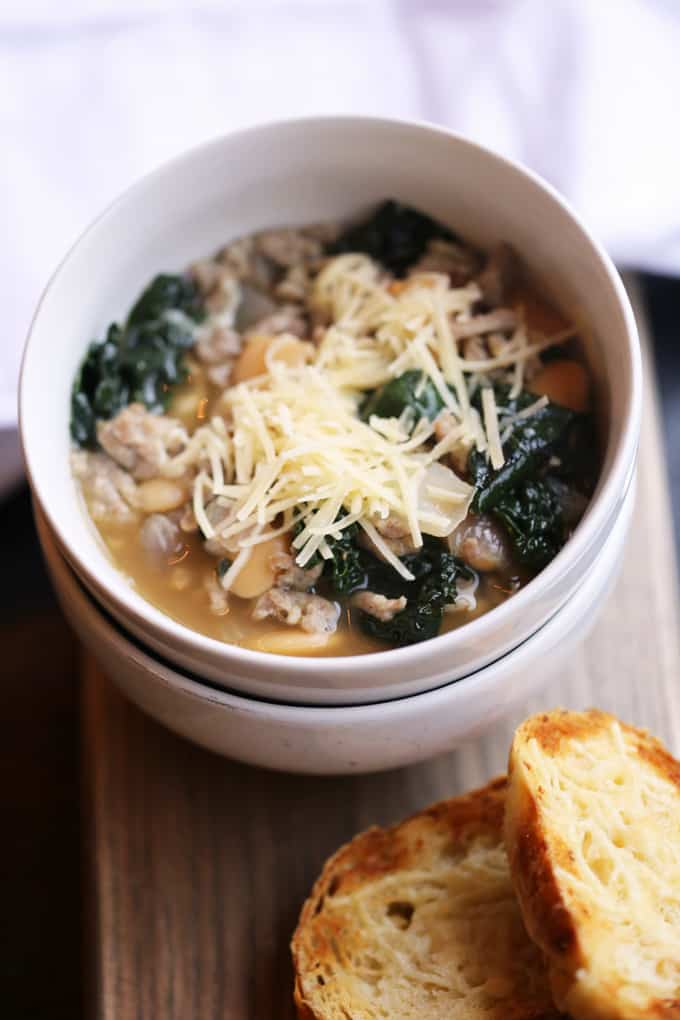Sausage Kale Soup with White Beans is a rustic, delicious, quick and easy soup that can be on the table in less than thirty minutes! kale recipes | kale recipes soup | kale soup