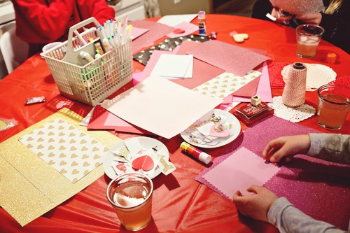 crafting table with supplies for making valentines