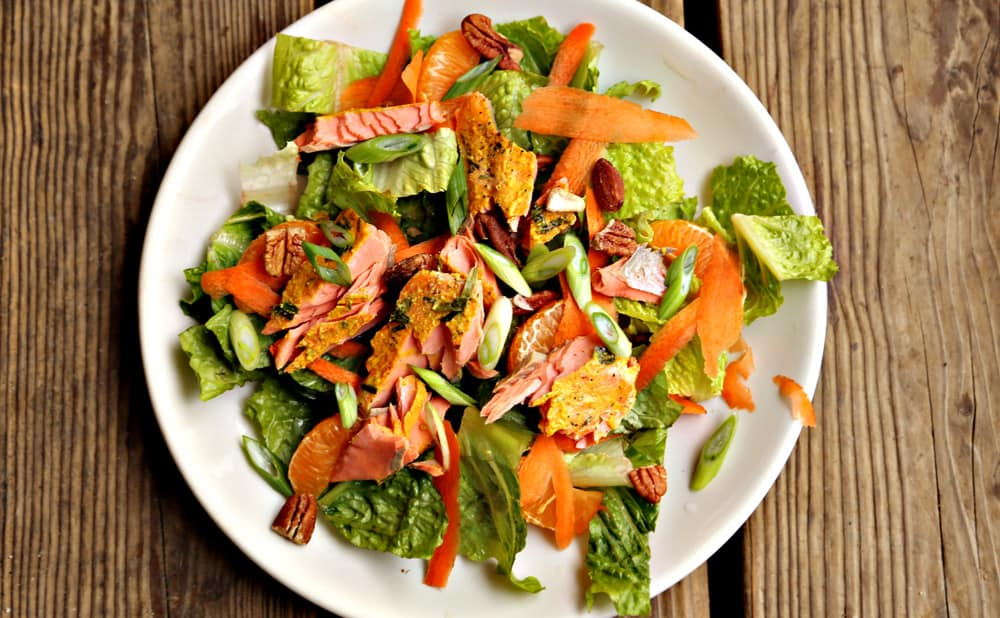 large round plate of citrus salmon salad