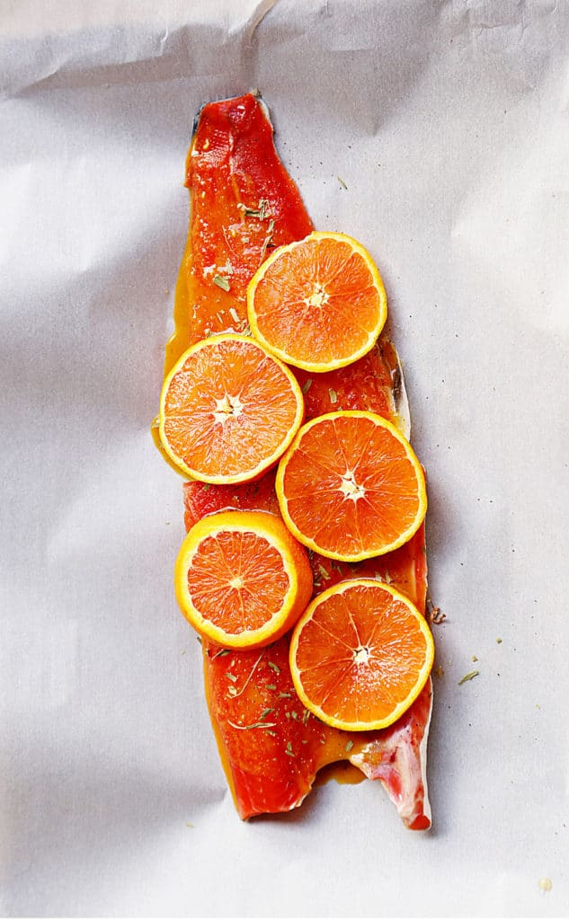 vibrant salmon fillet with glaze, herbs and citrus rounds