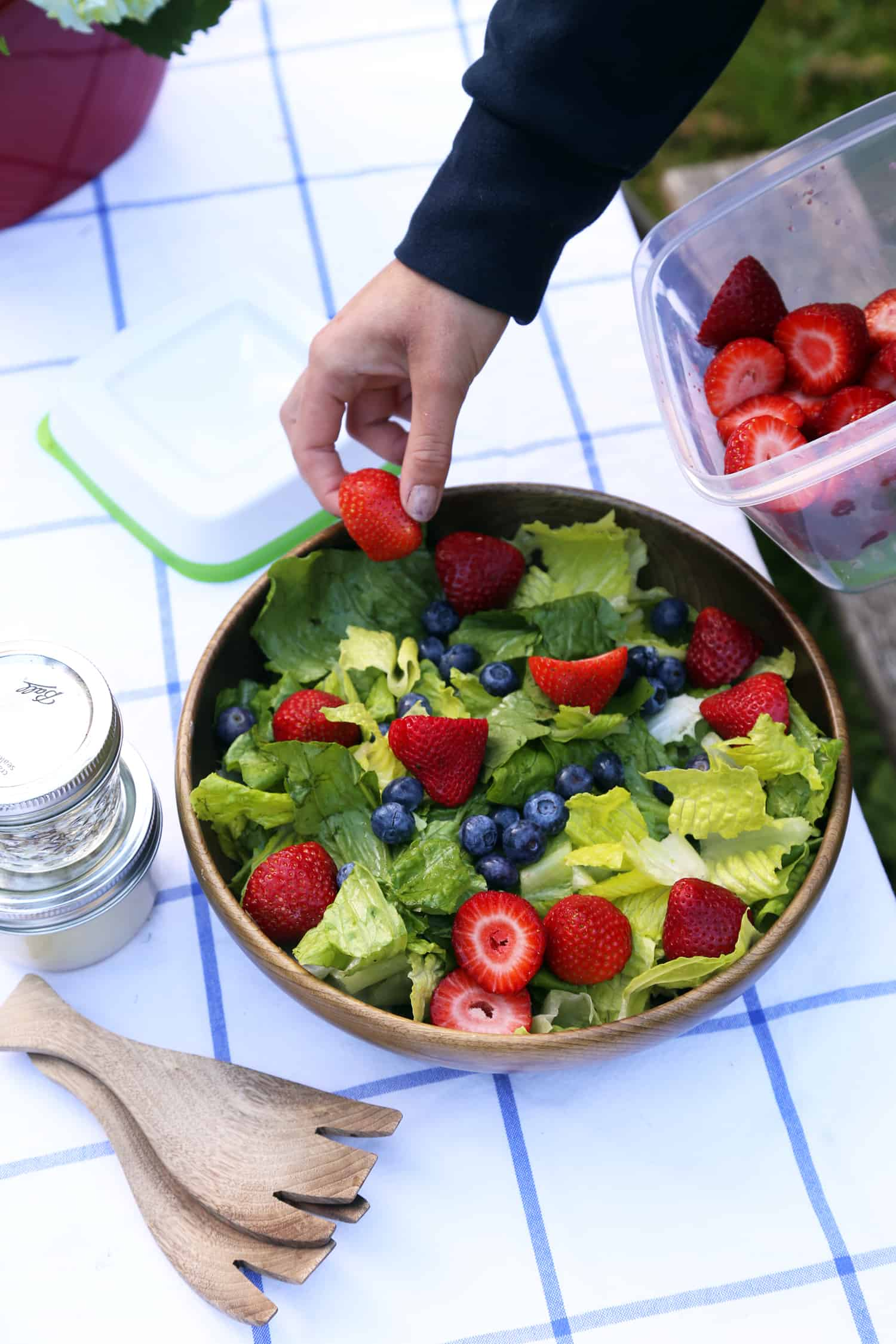 Red, White and Blue Summer Fruit Salad with Creamy Lemon Dressing is the perfect light, refreshing summer salad to bring to parties, picnics and potlucks. fruit salad recipe | strawberry salad | summer salad lemon dressing | potluck recipe | picnic salad