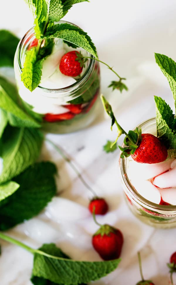 Light and refreshing Strawberry Mint White Wine Spritzer combines fresh strawberries, mint leaves and wine with sparkling water. wine spritzer | wine pitcher cocktail | party pitcher