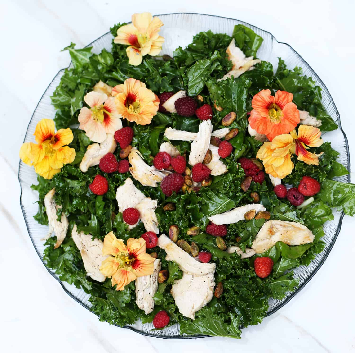 Raspberry Kale Salad with Edible Flowers, shrub vinaigrette and grilled chicken - great seasonal summer dinner meal recipe idea