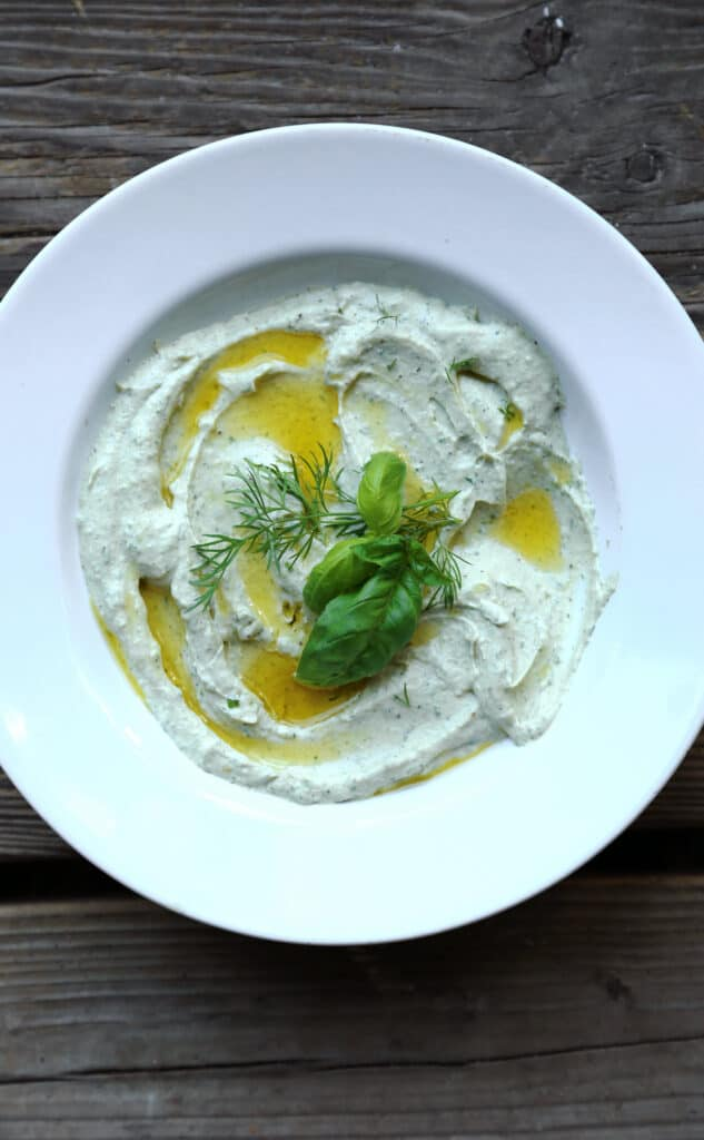 Whipped Feta Herb Dip is a flavorful addition to crudites with feta cheese whipped until light and fluffy with roasted garlic and loads of fresh herbs. easy dip recipe |creamy dip | whipped feta