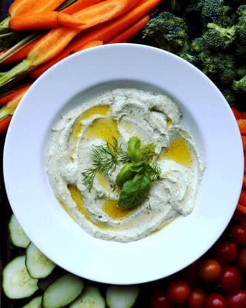 Whipped Feta Herb Dip is a flavorful addition to crudites with feta cheese whipped until light and fluffy with roasted garlic and loads of fresh herbs. easy dip recipe  creamy dip   whipped feta