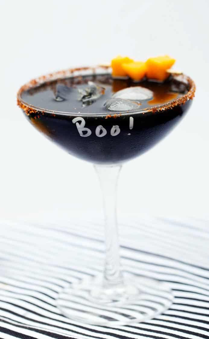 Mango margarita recipe a black halloween cocktail with activated charcoal powder!