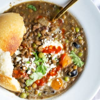 green lentil stew with fresh herbs and sourdough bread