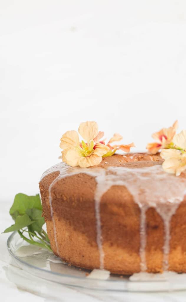 Banana chiffon cake with lemon glaze and edible flowers