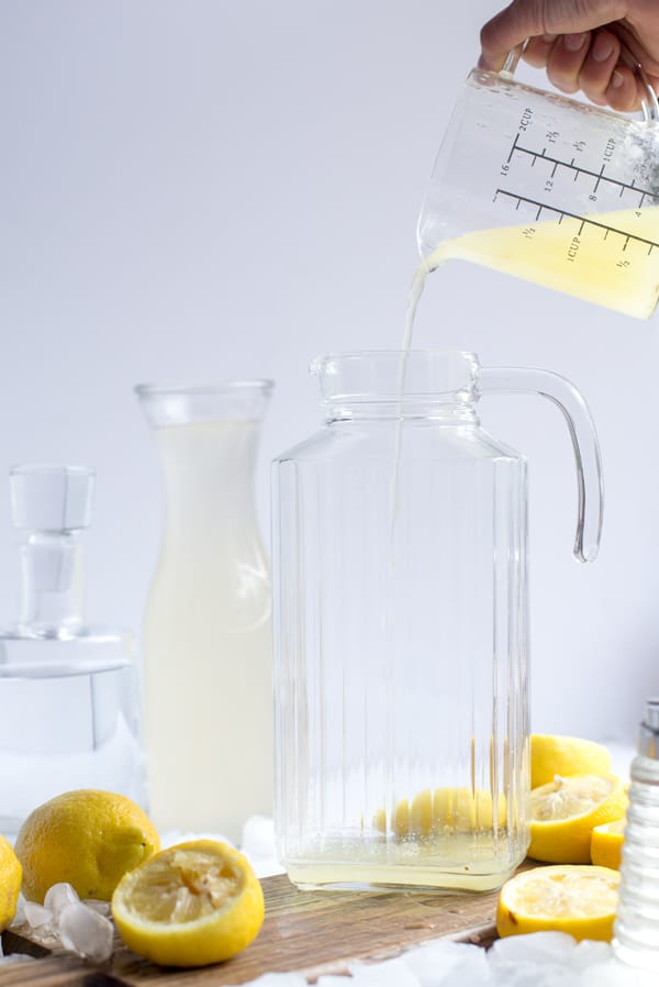 ingredients for coconut lemon sour party pitcher - classic simple syrup, coconut water, fresh lemon juice, chilled vodka and ice