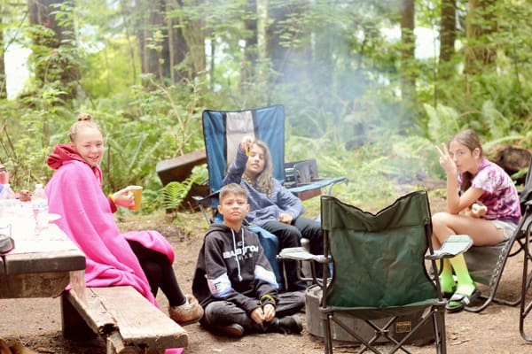 kids around a campfire