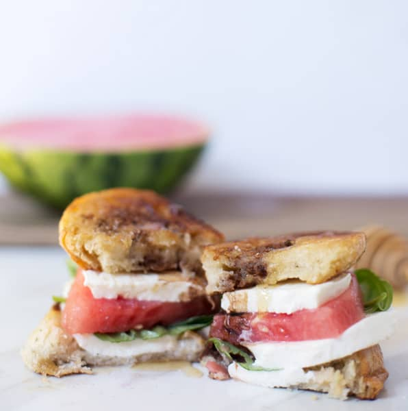 Watermelon Caprese Grilled Cheese may make you take a double take. Not only because it's beautiful and pink and absolutely mouth watering, but also because it's a little weird. But trust me, this combination WORKS. Each ingredient adds a little something different in terms of flavor and texture and every bite leaves you wondering what the next has in store. Watermelon Caprese | Caprese Grilled Cheese | How to Make Caprese Grilled Cheese | Recipe from ONEarmedMAMA.com @1armedmama