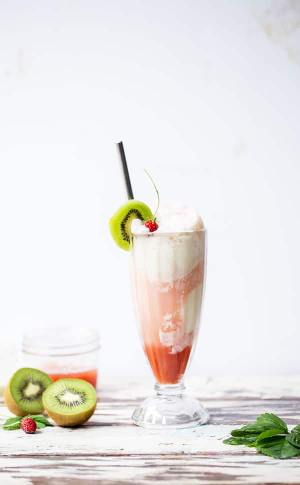 Sweet, refreshing and completely decadent you would never believe this Strawberry Kiwi Cream Float is made completely without soda! #GetFizzy @SparklingIce #ad soda replacement | fruit floats | fruity ice cream float