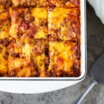 Taco Lasagna is a simple layered pasta dish with no bake noodles, loads of cheddar cheese and cumin-spiked beefy tomato sauce made from frozen taco filling that is sure to become one of your family's favorite weeknight meals! #SealToSavor #CollectiveBias #ad @FoodSaver