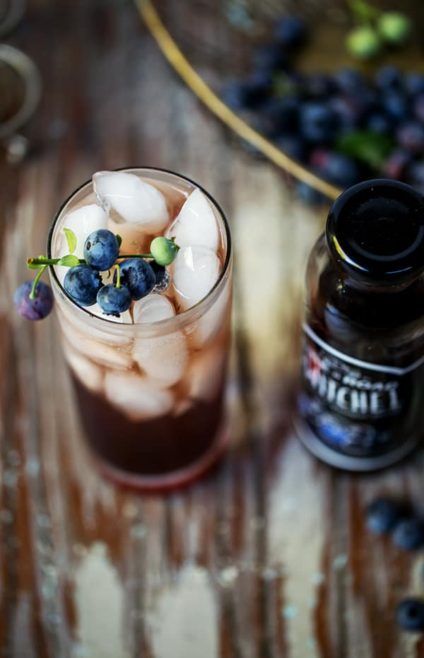 Spiked Blueberry Switchel Spritzer is a refreshing, fruity and fizzy way to get your drinking vinegar fix! Spiced rum pairs perfectly with the warm ginger and bright blueberry flavors, but leave it and this delicious switchel cocktail becomes an equally invigorating mocktail! What is switchel | switchel cocktail | switchel with alcohol | blueberry switchel | vinegar drinks | 3 ingredients or less #cocktail #mocktail #rum #vinegar #blueberry