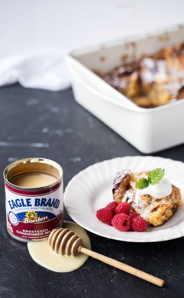 Crispy layered croissants coated in a custard of Eagle Brand Sweetened Condensed Milk, cinnamon and eggs then baked until puffy this Cinnamon Croissant French Toast Bake is decadent and delicious, but also totally easy to make AND can be made a day in advance. Perfect for the holidays or any time of year! croissant french toast | french toast casserole | croissant french toast bake | overnight | easy brunch for a crowd | make ahead holiday breakfast | baked french toast | baked french toast casserole | baked french toast recipe #ad @eaglebrand