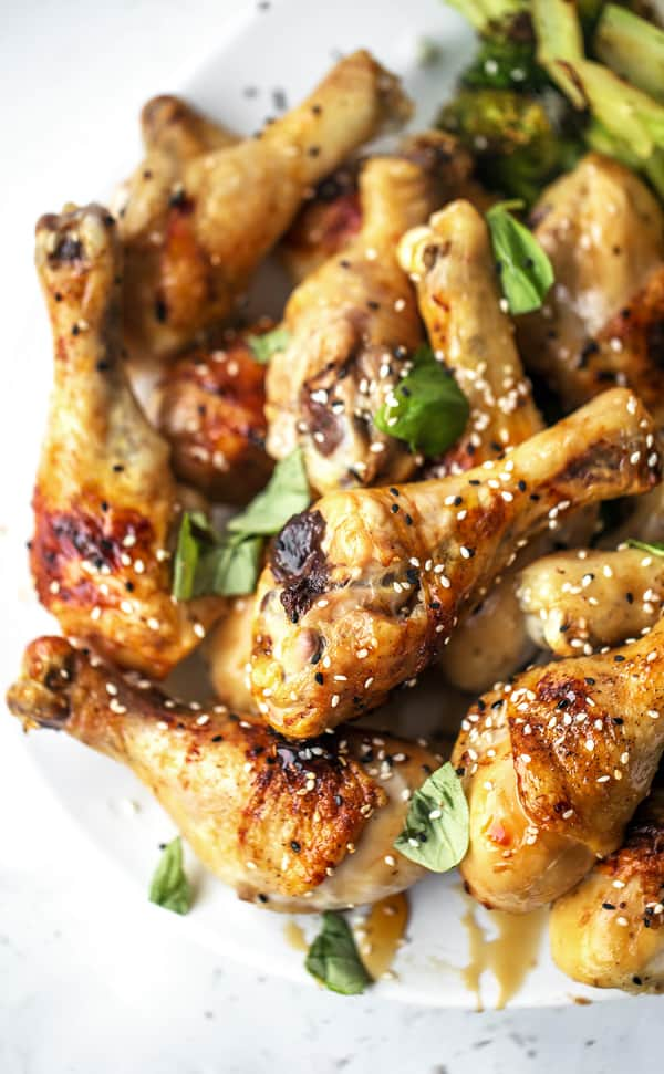 Baked Honey Ginger Chicken is an easy weeknight dinner recipe with tender meat, crispy skin and big flavor! baked chicken | legs breast thigh tenders tenderloins | recipes | honey baked chicken | soy | garlic | glazed | easy chicken recipes for dinner | gluten free | baked chicken for a crowd