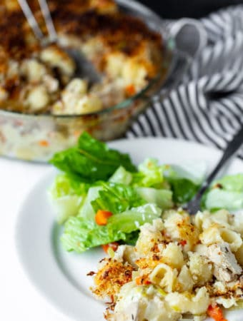 This modern take on classic Tuna Casserole is made with a homemade creamy base, fresh produce, loads of flavor and yummy crispy garlic topping. How to make tuna casserole from scratch | easy tuna noodle casserole bake recipe | best tuna casserole without soup recipes.