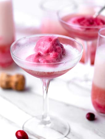 Frozen Cranberry Apple Cider Mimosas are a grown up boozy float made with frozen cranberry apple cider and champagne!