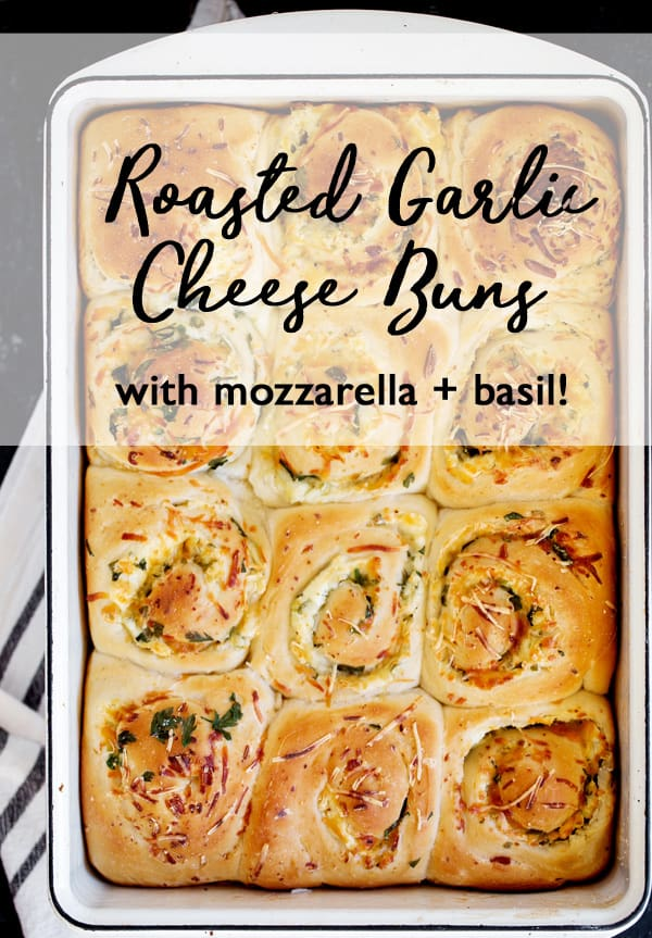 Roasted Garlic Cheese Buns are a savory take on the classic cinnamon roll. Stuffed with three cheeses, loads of garlic and fresh herbs these savory buns are great accompanimentto any meal! #ad @BridgfordFood#bridgford, #bridgfordfoods #bridgfordkitchen #bakingwithbridgford cheese buns  Breakfast buns recipe   savory rolls   how to make garlic bread   easy cheese rolls recipe   roasted garlic bread   make ahead freezer meals   breakfast   for a crowd   garlic rolls   quick easy garlic rolls   cheese stuffed buns   cheese buns in oven   cheese filling for buns   garlic rolls with cheese inside   garlic rolls from frozen bread dough   garlic rolls with cream cheese