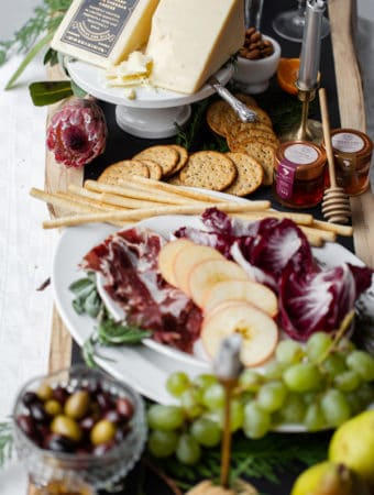 Simple to put together, this Upscale Charcuterie Grazing Table is sure to WOW guests over the holidays. Or any time of year!  what to pair with aged cheddar | appetizers | canape ideas | fancy | christmas | new years eve | champagne and cheese #Tillamook #dairydoneright #ad @tillamook