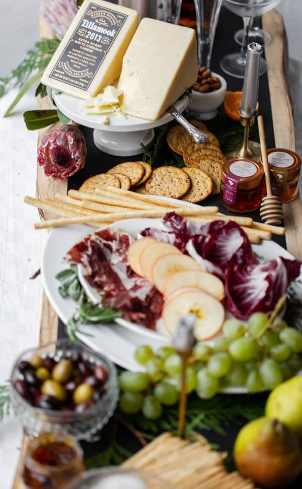 Simple to put together, thisUpscale Charcuterie Grazing Table is sure to WOW guests over the holidays. Or any time of year! what to pair with aged cheddar | appetizers | canape ideas | fancy | christmas | new years eve | champagne and cheese #Tillamook #dairydoneright#ad @tillamook