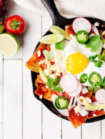 Easy Skillet Chilaquiles turn pantry staples like stale tortillas and canned tomatoes into a filling, fresh, and vibrant breakfast for one or for a crowd! How to make Easy Chilaquiles recipe with tomato sauce baked eggs | how to pronounce | rojos verdes breakfast gluten free vegetarian