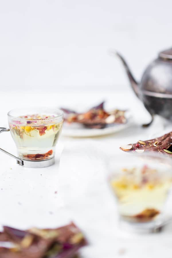 With common foods, edible flowers and adaptogens it's easy to whip up a delicious Aphrodisiac Chocolate Bark just in time for Valentine's Day! aphrodisiac how do they work, meaning, food, herbs | adaptogens | edible flowers | valentines day gifts | Chocolate bark | aphrodisiac desserts |