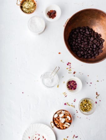 With common foods, edible flowers and adaptogens it's easy to whip up a delicious Aphrodisiac Chocolate Bark just in time for Valentine's Day! aphrodisiac how do they work, meaning, food, herbs   adaptogens   edible flowers   valentines day gifts   Chocolate bark   aphrodisiac desserts  