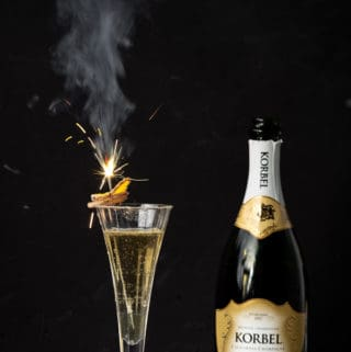 With a simple ginger infused simple syrup on hand it's easy to celebrate (anytime!) with festive cocktails like the Ginger Sparkler! ginger | ginger cocktails | uses for ginger | ginger cocktail syrup | champagne cocktails | new years drink | fresh ginger cocktails