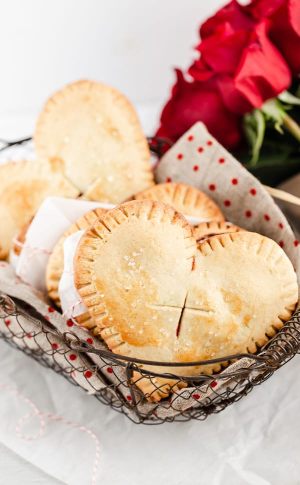 heart shaped hand pies in a vintage wire basket french  red polka dot napkin and red roses