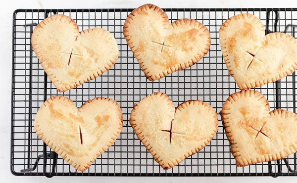 lime cherry hand pies cooling on wire rack black and white minimal food photography