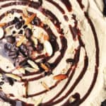 swirls of chocolate, slivered almonds and coffee beans on a coffee chocolate cream pie