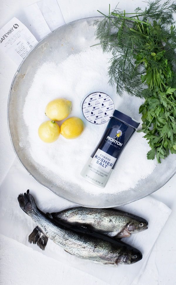 Find yourself with a whole fish and wondering how to cook it? This Salt Baked Fish method honors the beautiful whole fish with an equally stunning and delicious preparation.  Baked fish fillets | salt crusted fish | salmon recipe | baked fish with salt crust | #ad @MortonSalt @Safeway