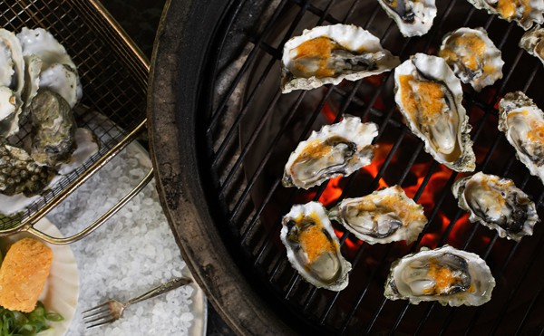 oysters on the half shell over open flame on big green egg with compound butter