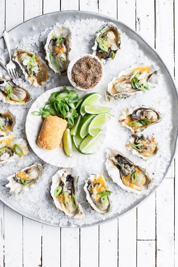 Tray of half shell oysters with lime miso butter scallions and togarashi