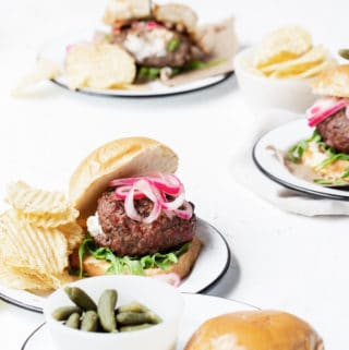 Whether grilling in the campground, on the patio, or over the stove top, Chèvre-Stuffed Burgers with Onion Jam and Arugula are delicious, unexpected, and sure to impress. How to make stuffed burgers | chevre goat cheese recipes | @Montchevre® #ad