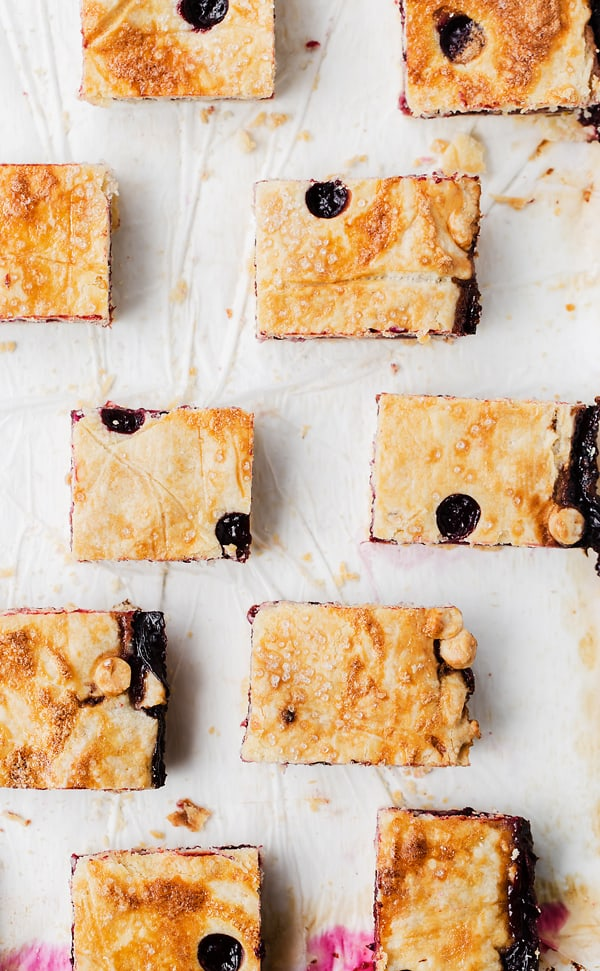 Nectarine Berry Slab Pie Bars are a great portable sheet pan dessert made from fresh fruit and flaky lemon pastry. Perfect for parties and potlucks! blackberry pie | berry desserts recipes | triple berry slab pie | blueberry nectarine blackberry sheet pan dessert bars |