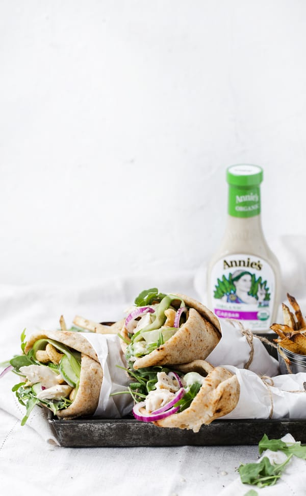 Cashew Caesar Chicken Wraps bring fresh flavor and texture to the table FAST whether served warm for dinner or wrapped up as a fabulous meal prep lunch.    Chicken   Caesar wrap pita recipe   chicken wrap   cashew chicken   howto make   recipe   video #sponsored #feedfeed #annies