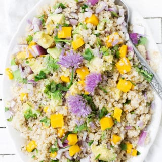 Mango Avocado Quinoa Salad mixes juicy mangoes and creamy avocado with a bright lemon dressing and loads of fresh herbs. A delish way to use up leftover quinoa! Mango Avocado Quinoa Salad | quinoa recipe | how to make quinoa salad | mango salad | quinoa salad dressing | easy vegan quinoa salad recipe