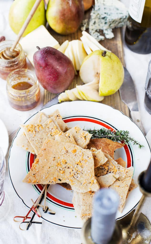 With this delicious appetizer recipe, menu ideas, wine and cheese information you'll be confident in hosting your own wine and cheese pairing party!  wine and cheese pairing | homemade cheese crackers | wine tasting party #ad #CastelloCheese #parties #wineandcheese #winepairings #dinnerparty #holidays @CastelloUSA