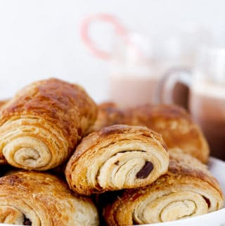 Chocolate Croissants, or pain au chocolat in French, are a special treat to start making with your family as a holiday tradition over the holidays and a delicious make ahead idea for breakfast any time of year! chocolate croissant recipe | how to make chocolate croissants | christmas traditions | cooking with kids | make ahead christmas breakfast #ad
