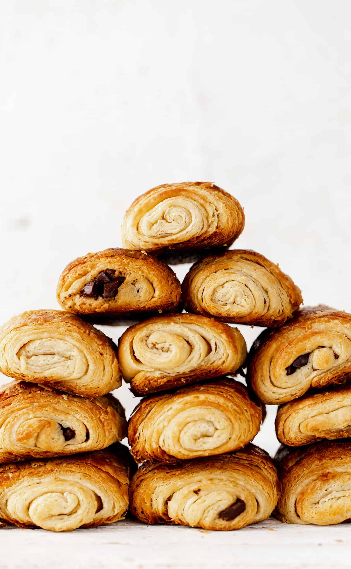 Chocolate Croissants, or pain au chocolat in French, are a special treat to start making with your family as a holiday tradition over the holidays and a delicious make ahead idea for breakfast any time of year! chocolate croissant recipe   how to make chocolate croissants   christmas traditions   cooking with kids   make ahead christmas breakfast #ado