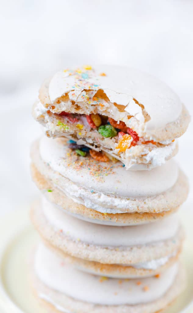 Fruity PEBBLES™ Cereal Milk Macarons are a perfect classic vanilla macaron shell with colorful flecks of tropical fruit flavored cereal and finished with a cereal milk cream macaron filling. Fruity PEBBLES™ Cereal milk macarons recipe   macarons filling ingredients   Fruity PEBBLES™ cookies   gluten-free baking #recipe #glutenfree #cookies #ad