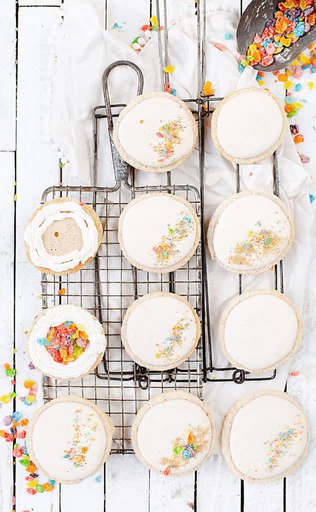 Fruity PEBBLES™ Cereal Milk Macarons being filled with cereal milk cream and Fruity PEBBLES™