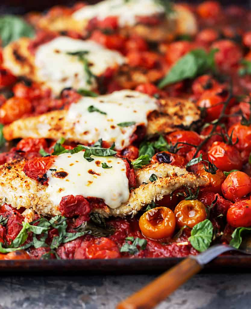 Easy One – Tray Baked Chicken Parmesan with Roasted Tomato Sauce is full of garlic, cheese, fresh herbs, and tomato sauce with bursted tomatoes and deep rich flavor. | easy baked chicken parmesan recipe | parmesan crusted tray bake chicken with lemon, garlic, pasta and spinach recipe #sponsored by @muirglen @thefeedfeed #MyMuirGlen #feedfeed