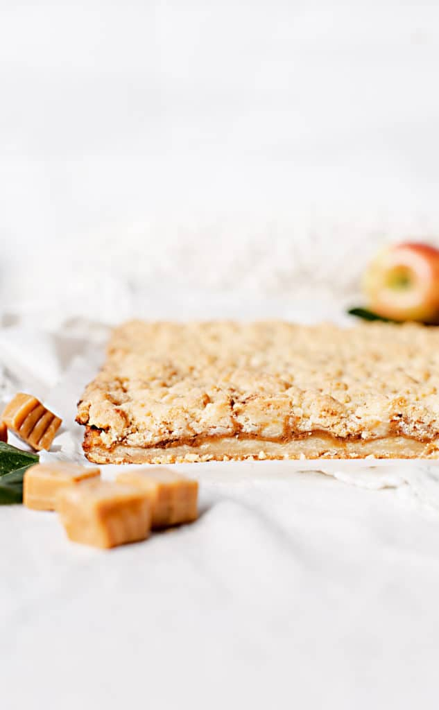 Caramel Apple Pie Bars are a complete showstopper handheld dessert with buttery shortbread crust, caramel apple filling and finished with a mile-high crumble topping. apple slice sheet pan recipe   salted caramel apple pie bars dessert