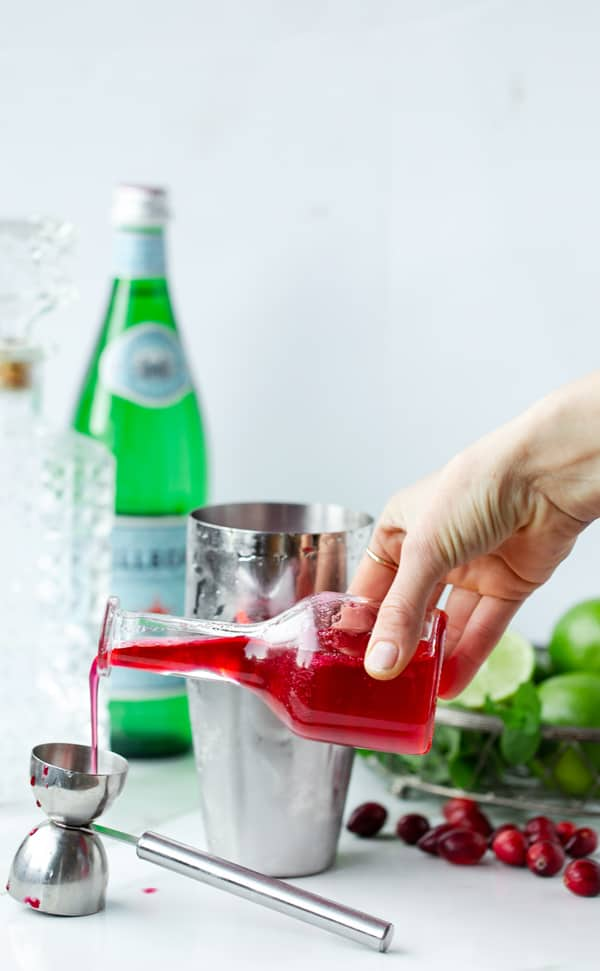 The Jolly Ole  Christmas Cocktail is festive without being over-the-top. Light and fruity with just the perfect amount of red and green holiday cheer! christmas cocktail recipes   cranberry mint cocktail   vodka cocktails   holiday drink ideas